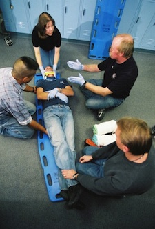 Picture of students working towards their Emergency Medical Technician-Basic Certificate at CMC.