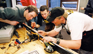 Picture of students earning their Ski and Snowboard Shop Technician Certificate at CMC.